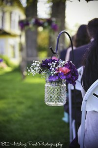 Hobnail glass jars with purple and pink silk flowers