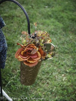 Muted fall silk flowers in copper container