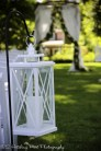 White lanterns on shepherd's hooks