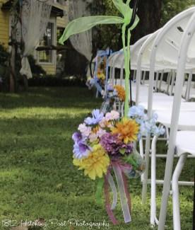Multicolored bouquet in ribbon hung mason jar