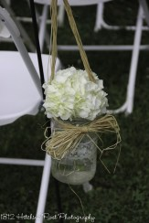 White hydrangea in lace trimmed mason jar
