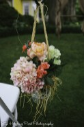 Silk pinks, peach, and coral in lace trimmed mason jar