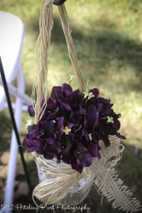 Plum silk flowers in mason jar