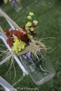 Red and yellow silk flowers in mason jar