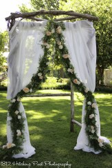 White drapes with live flower garland