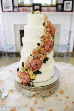 Peonies and Ranunculous Cake in peach and coral