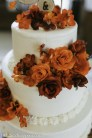 Orange and deep red roses on cake
