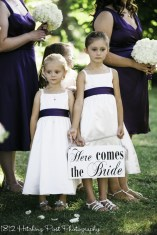 "Flower girls with ""Here Comes the Bride"" sign"