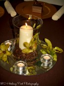 Chocolate brown and green centerpiece with candle