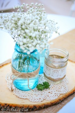 Blue and clear mason jars with burlap and twine