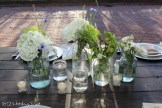 Cluster of clear mason jars with mums