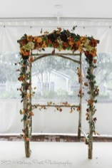 Arbor under tent with silk fall leaves and flowers