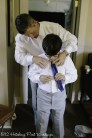 Groom helps son dress