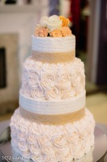 Wedding cake with blush roses and burlap ribbon