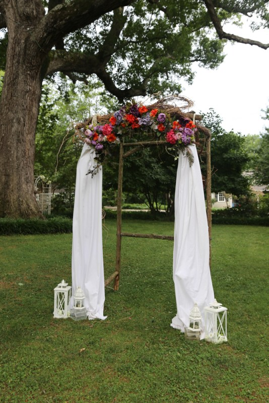 White solid drapes free flowing with live flowers