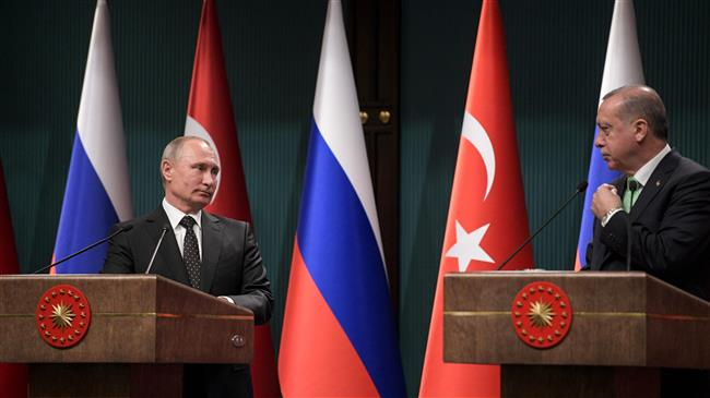 Russian President Vladimir Putin (L) and his Turkish counterpart Recep Tayyip Erdogan give a joint press conference at the Presidential Complex in Ankara, Turkey, on December 11, 2017. (Photo by AFP)