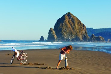 2012-Spring-Oregon-Coast-Travel-Cannon-Beach-Haystack-Rock-woman-clam-digging-sand-ocean