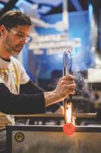 """Hugh Willa; Hugh is using """"jacks"""" to create a neckline between the glass and the blowpipe"""