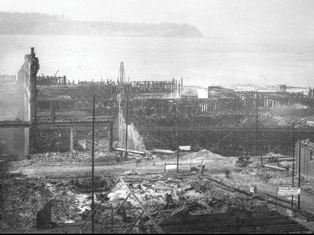 Destroyed wharves in the fire's wake. (photo: University of Washington Libraries, Special Collections, A. Curtis 36929)