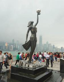 The Hong Kong film industry is celebrated through sculpture along the Avenue of Stars.