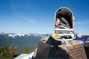 At the top, a mailbox contains hikers' mementos.