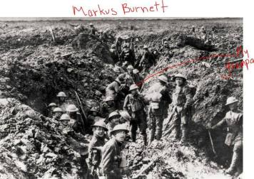 The soldier in the center is identified at Private Markus Burnett.