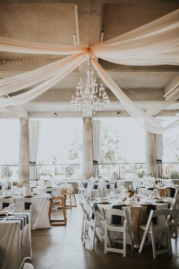 6 panels of blush organza fabric, 2-Tier Crystal Chandelier, 4 strands of twinkle lights