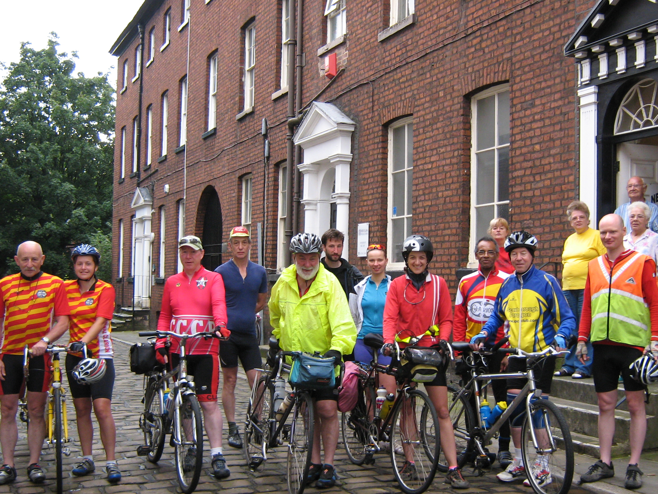 Cyclist in front of Bolton Socialist Club