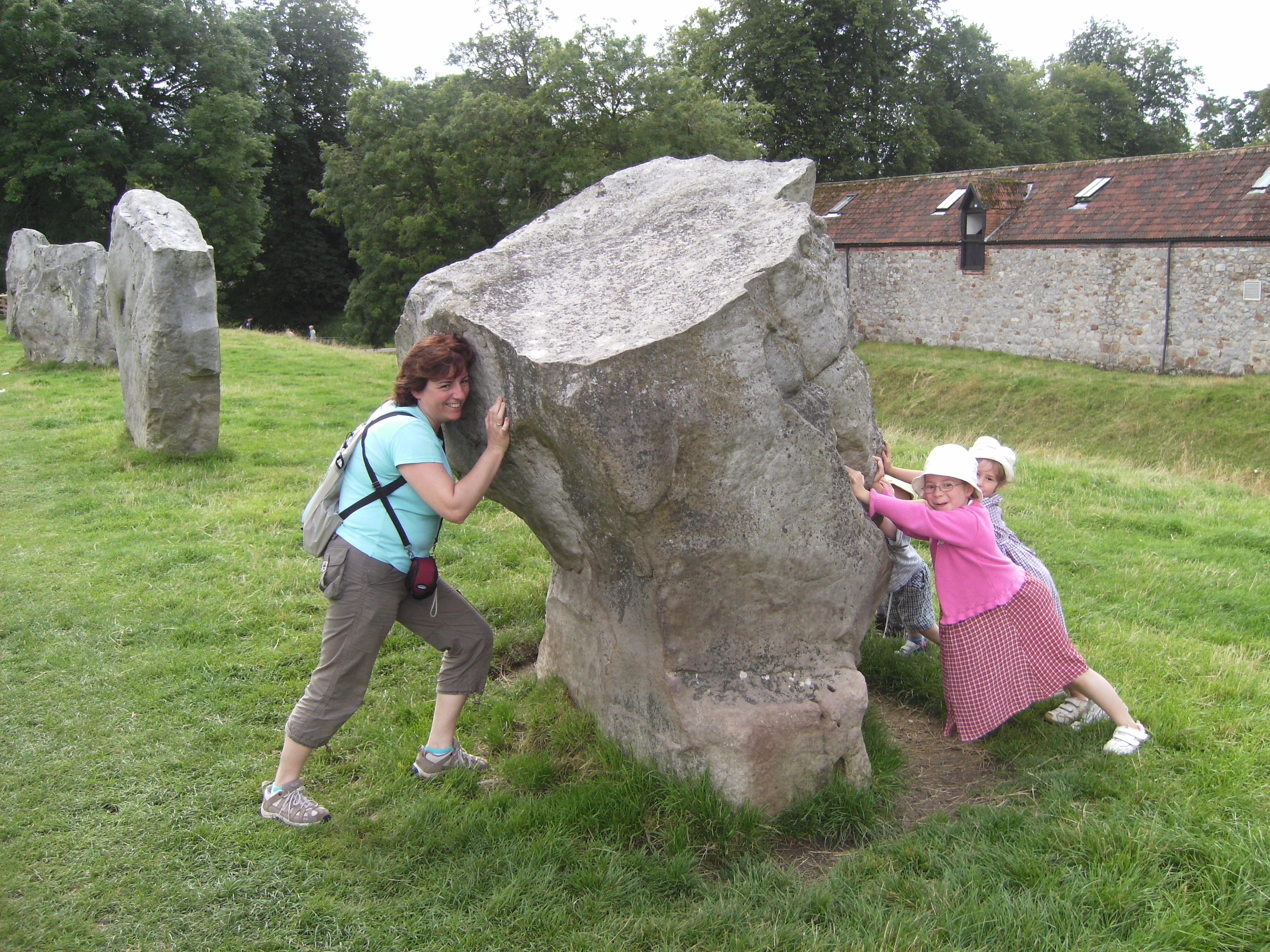 Merce trying to reset the Avebury stones despite some awkward children