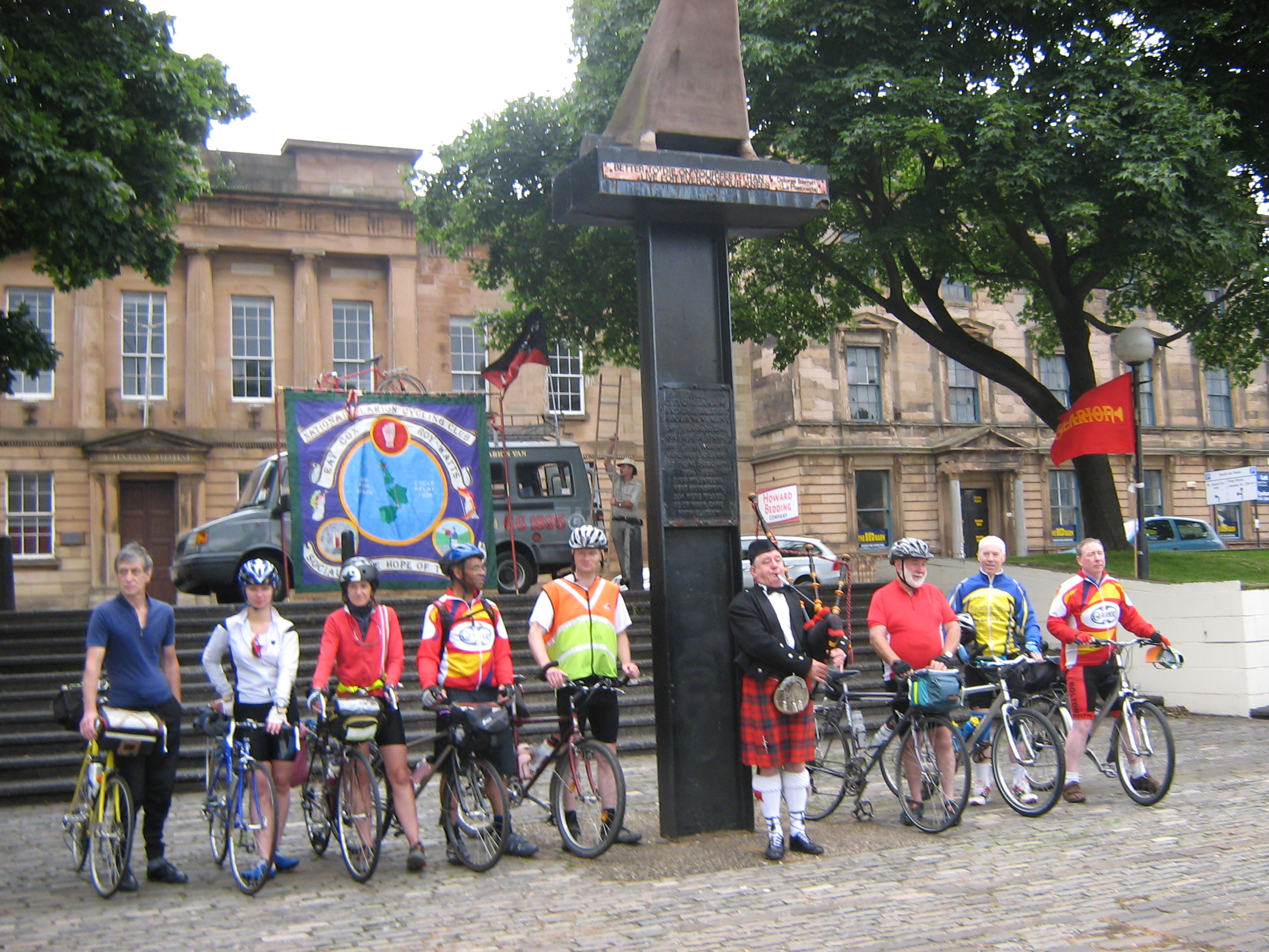 Cyclists in front of the International Brigade memorial on the River Clyde in Glasgow