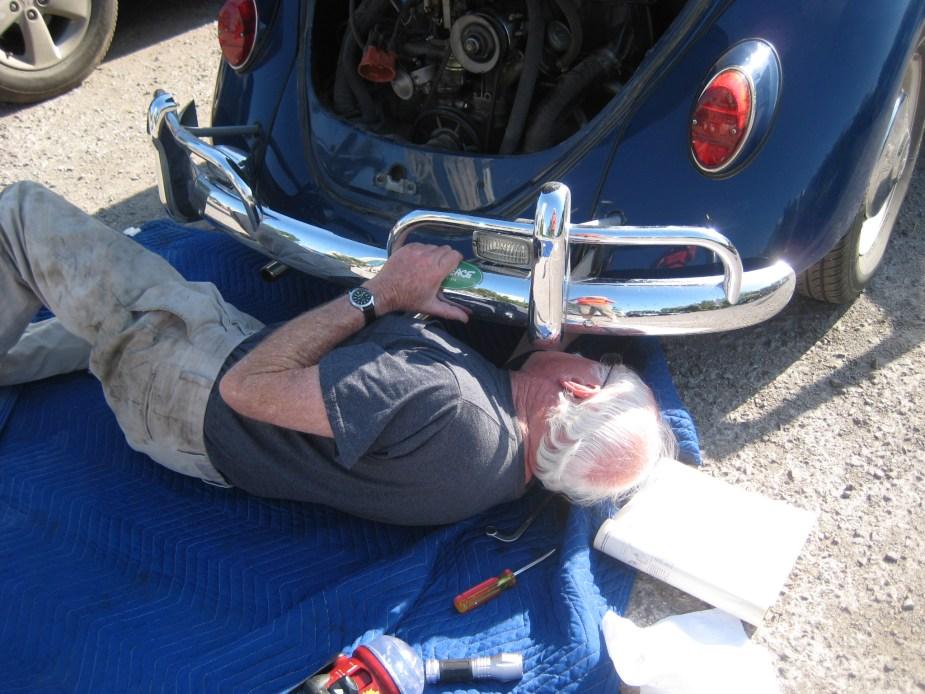 Caption: Ed adjusts valves in the hotel parking lot in Astana, Kazakhstan