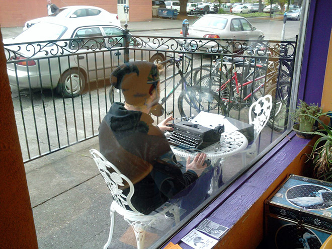 Hipster working from a cafe.