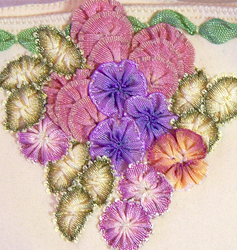 Close up of ribbon worked flowers and leaves