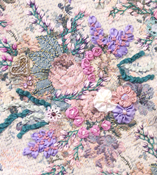 Close up view of silk ribbon embroidery with ribbon worked flowers