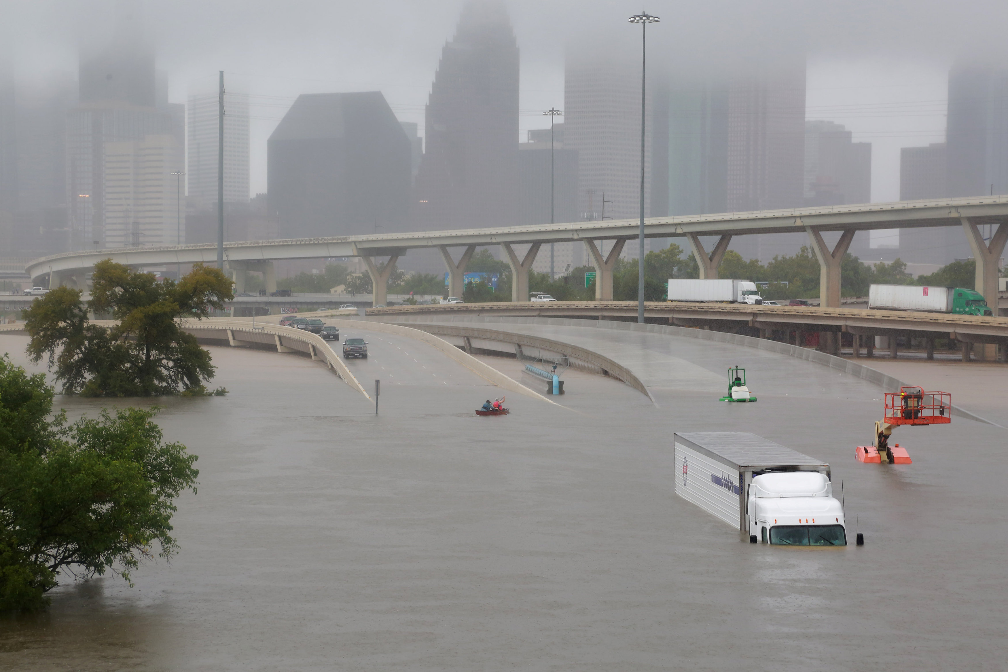 "A Houston interstate is submerged in water after Hurricane Harvey brought widespread flooding to the area.  The devastating impact strong and more frequent rainstorms are having on the city was detailed in The Texas Tribune/ProPublica's ""Boomtown, Flood Town"" months before Harvey hit"