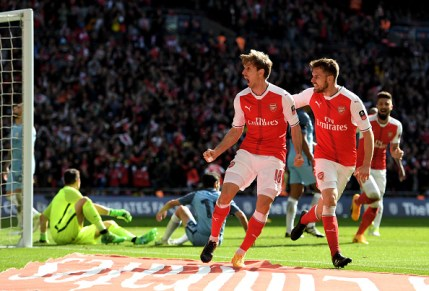 LONDON, ENGLAND - APRIL 23: Nacho Monreal (L) of Arsenal celebrates scoring his sides first goal during the Emirates FA Cup Semi-Final match between Arsenal and Manchester City at Wembley Stadium on April 23, 2017 in London, England. (Photo by Shaun Botterill/Getty Images,)