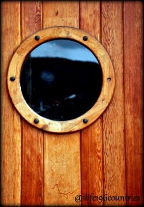 round cedar window