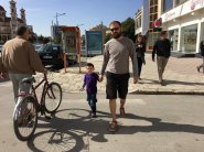 Me and my son, walking the streets of Korce.