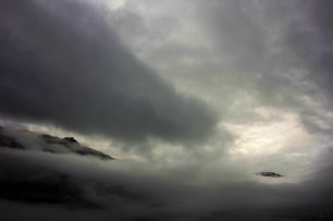 First appearance of the sky through the clouds on the morning over the Bohinj Lake.
