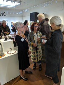 Elizabeth Bass (right) with Bonnie Lambert and other gallery visitors