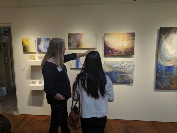 Linda McCray shares her inspirations with a gallery customer