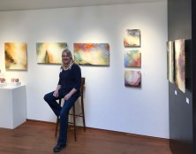 Linda McCray in front of her solo show
