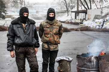Protester with his son, at the barricades on Hrushevskoho. Kiev.