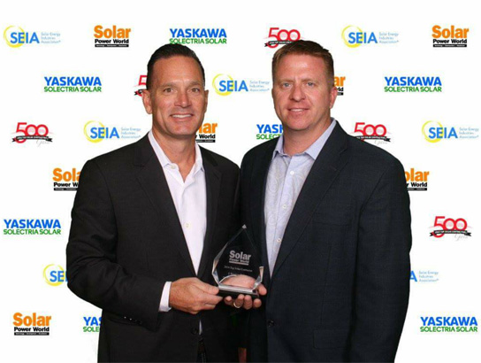 Todd Miller and Travis Hodapp accept the Top 500 Solar Contractor Award at Solar Power World International Conference in Las Vegas, NV.