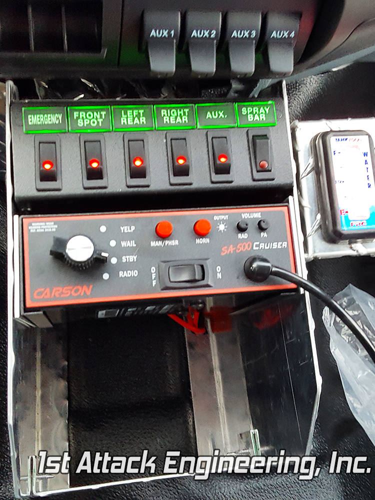 Rives Tompkin's custom center console with radio, siren, light switches