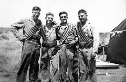 """The .50 cal machine gun outfit of the 24th Marines. Chuck [Podolski], me [Pope], Blackie [Poggioli] and Pinkey. Camp Pendleton."""