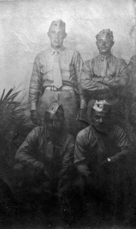 George Smith, Peter Colombo, Albert Zrimsek (corpsman) and Edward Horan. Taken at a souvenir photography establishment, 1944.