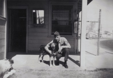 Sergeant George Smith with a canine companion at Barstow, California, during the Korean War.