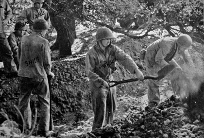 Men from Able Company's weapons platoon dig an emplacement for a halftrack while training with the regiment's weapon's company.