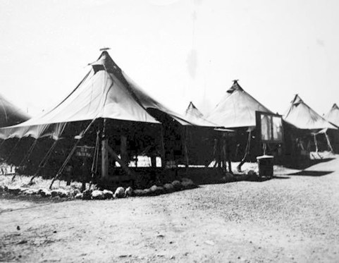 """The skipper's tent. Captain Irving Schechter worked out of this tent while at Camp Maui in the spring of 1944. The sign says """"C.O. CO A 1Bn 24th Mar."""""""